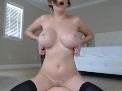 Big breasted girl sucks and rides her dildo