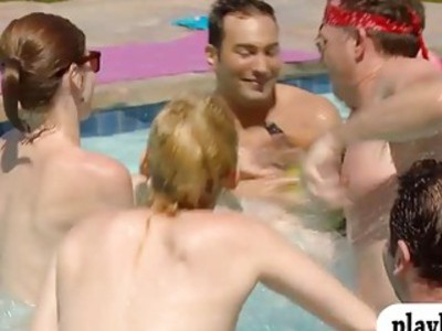 Swingers having fun and oral sex in swimming pool