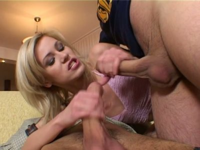 Short haired blondie Cora Carina rides and sucks two long dicks