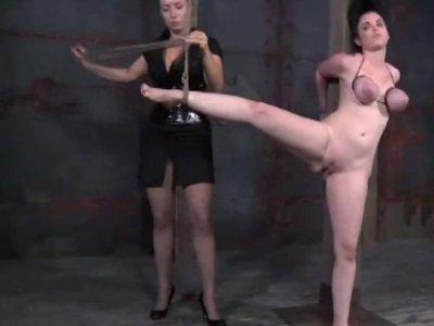 Brunette chick squeezes swollen boobies of nasty milf