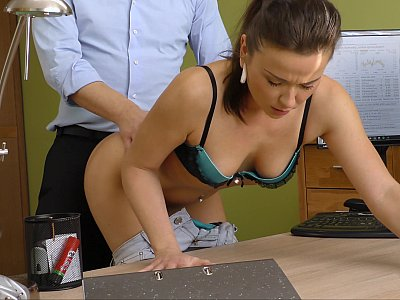 Naughty babe fucked on the office table