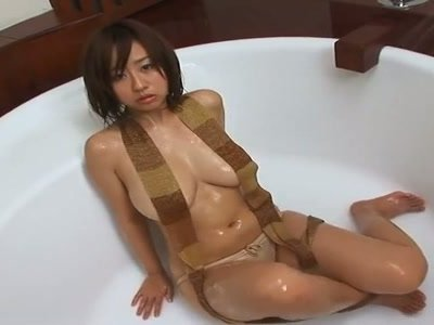 Busty brunette Jap chick Hitomi Kitamura all soaped up for show