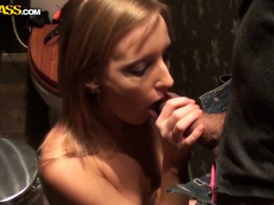 Pretty blonde babe gives a head in a public toilet
