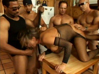 Several dudes enjoys one girl on a leach