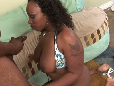 Rounded butt Sky Black posing on a cam and later bouncing on a fat cock