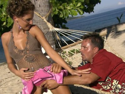 Tempting Lauren May mouthing a cock on a hammock