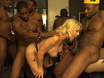 Girl enjoys an interracial gang-bang