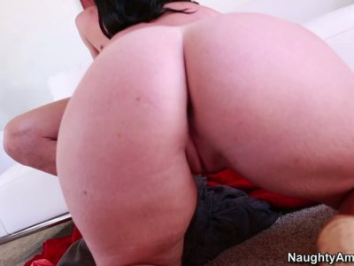 Buxom brunette chick Sophie Dee gives a hot titjob and gets poked hard from behind