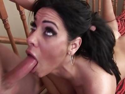 Big boobed brunette sucking cock